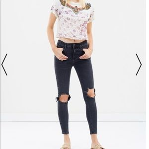 Free People dark washed ripped knee jeans